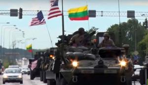 Tambores de Guerra. Cientos de vehículos blindados estadounidenses marcharon por Lituania en el marco de las maniobras militares multinacionales de la OTAN en el Báltico. (Foto RT)